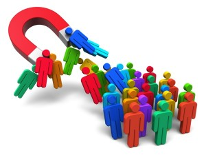 Social engineering concept: horseshoe magnet capturing crowd of color human figures isolated on white background
